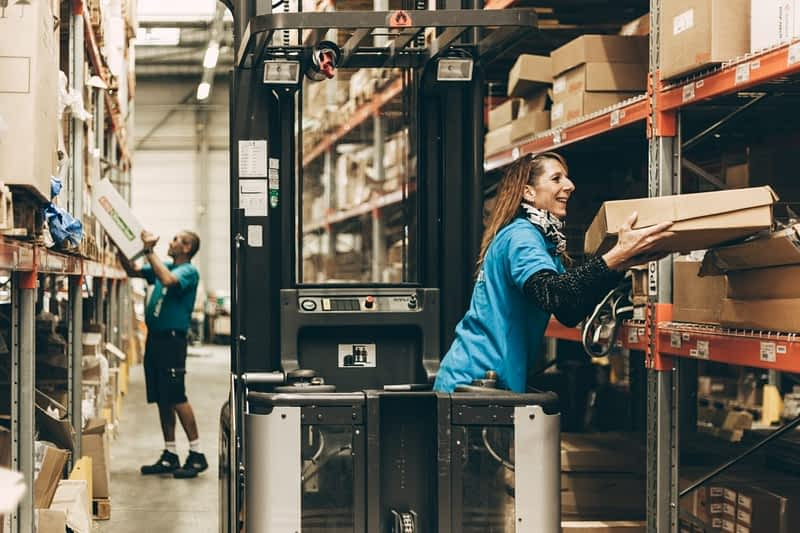 Happy working in a distribution center